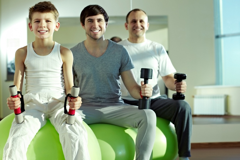 Boy Young Man And Older Man Holding Dumbbells
