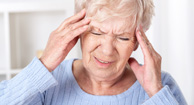 elderly woman with headache