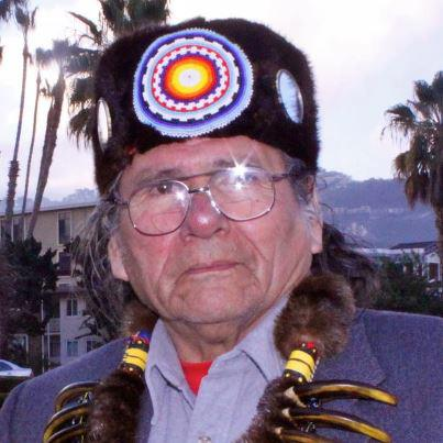 Dennis J Banks photo with headdress