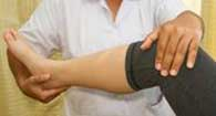 doctor treating patient with osteoarthritis of the knee