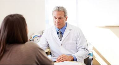 neurologist talking to patient with multiple sclerosis