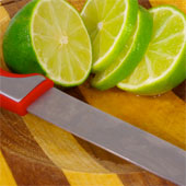 Limes sliced up on a cutting board.
