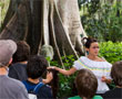 A Columbian guide gives visitors information about the rainforest.