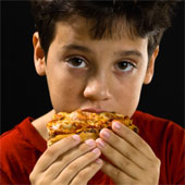 Child eating pizza.