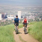 Couple mountain biking.
