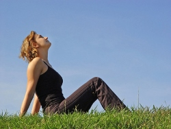 A woman practices breathing exercises.