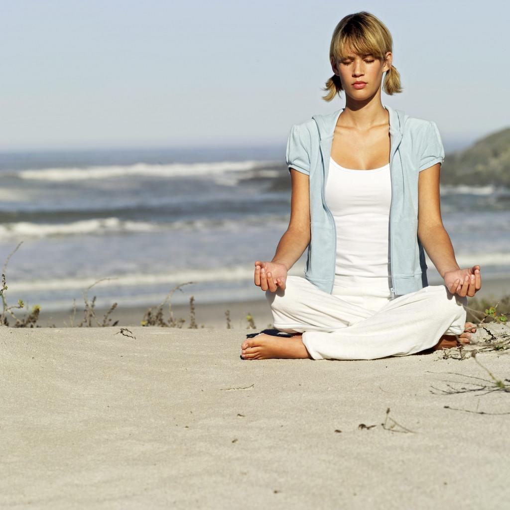 A woman meditates.