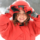 Child with a ski helmet.
