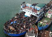 Haitian citizens crowd a ship near a port in Haiti