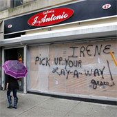 A store in New York city, boarded up in preparation for Hurricane Irene. Photo courtesy of David Shankbone (CC BY 3.0)