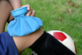 Applying an ice pack to a muscle strain.