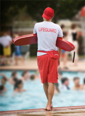 Lifeguard standing duty poolside.