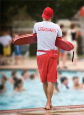 Lifeguard standing duty poolside.
