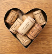 Wine corks arranged in a heart shape.