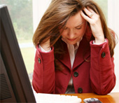 Stressed woman at desk.
