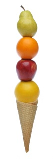 Stack of fruit on top of ice cream cone.