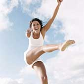Girl kicking her leg up in the air.