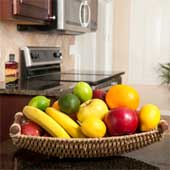 Fruit basket on the kitchen table.
