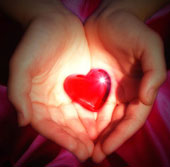 A heart being held in cupped hands