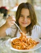 Hiding veggies - little girl eating spaghetti.