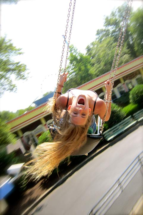 girl happy on swing