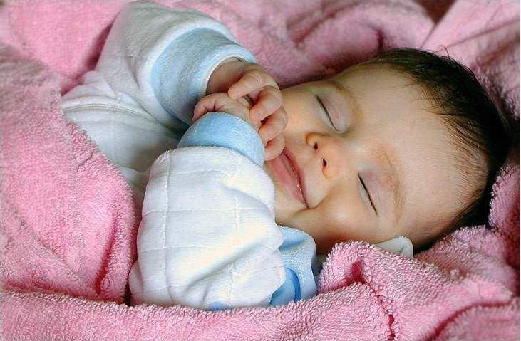 baby happily sleeping