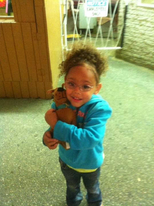 this little girl just won her first stuffed animal