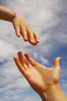 An image of two hands reaching out toward each other.
