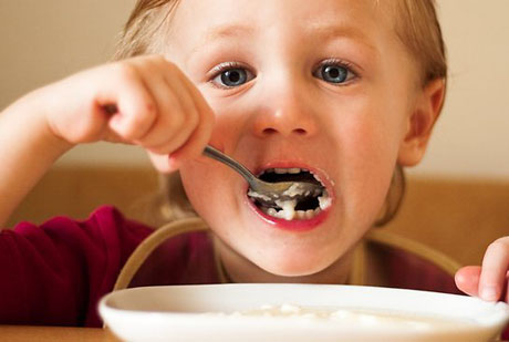 A child eating breakfast
