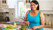woman with atrial fibrillation preparing a healthly lunch