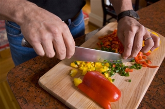 a man chopping vegetables