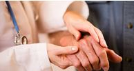 massaging a hand of someone with rheumatoid arthritis