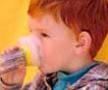 boy with allergies drinking juice