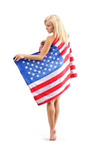 A young woman draped in the American flag. Image courtesy of iStockphoto.com