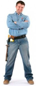 A man wearing a tool belt with his arms folded.
