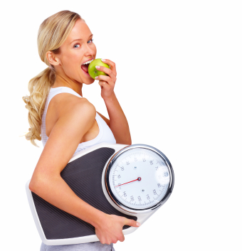 Fit woman eating apple