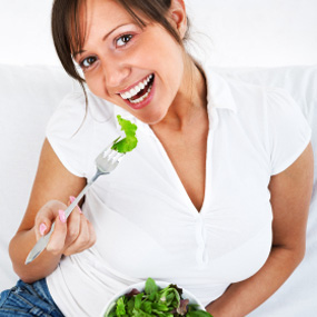 A woman with a salad