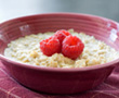 bowl of oatmeal with raspberries