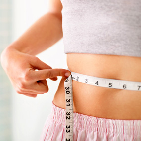 ruler measuring waistline