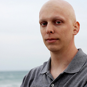 A man with no hair due to cancer treatment