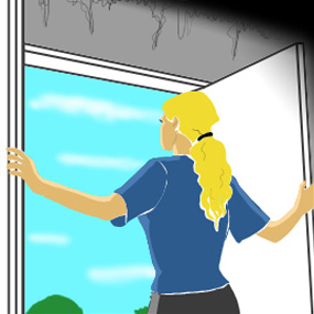 Woman looking through doorway to the outdoors