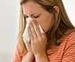 woman with allergies and tissue