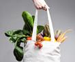 hand holding bag of vegetables