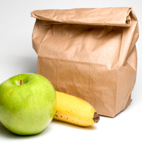 brown bag lunch with apple and banana