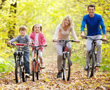 family having bike workout after holiday meal