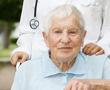 man with alzheimer's sitting in a wheelchair
