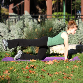A woman stretches her leg behind her to help ease arthritis pain in her hips.