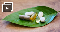 vitamins and supplements on a leaf