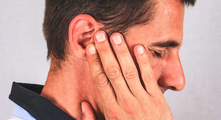What does it mean when you have a hard lump behind the left ear?