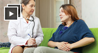 woman speaking with her doctor about ulcerative colitis